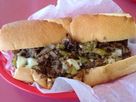 1280px-Cheesesteak_heaven